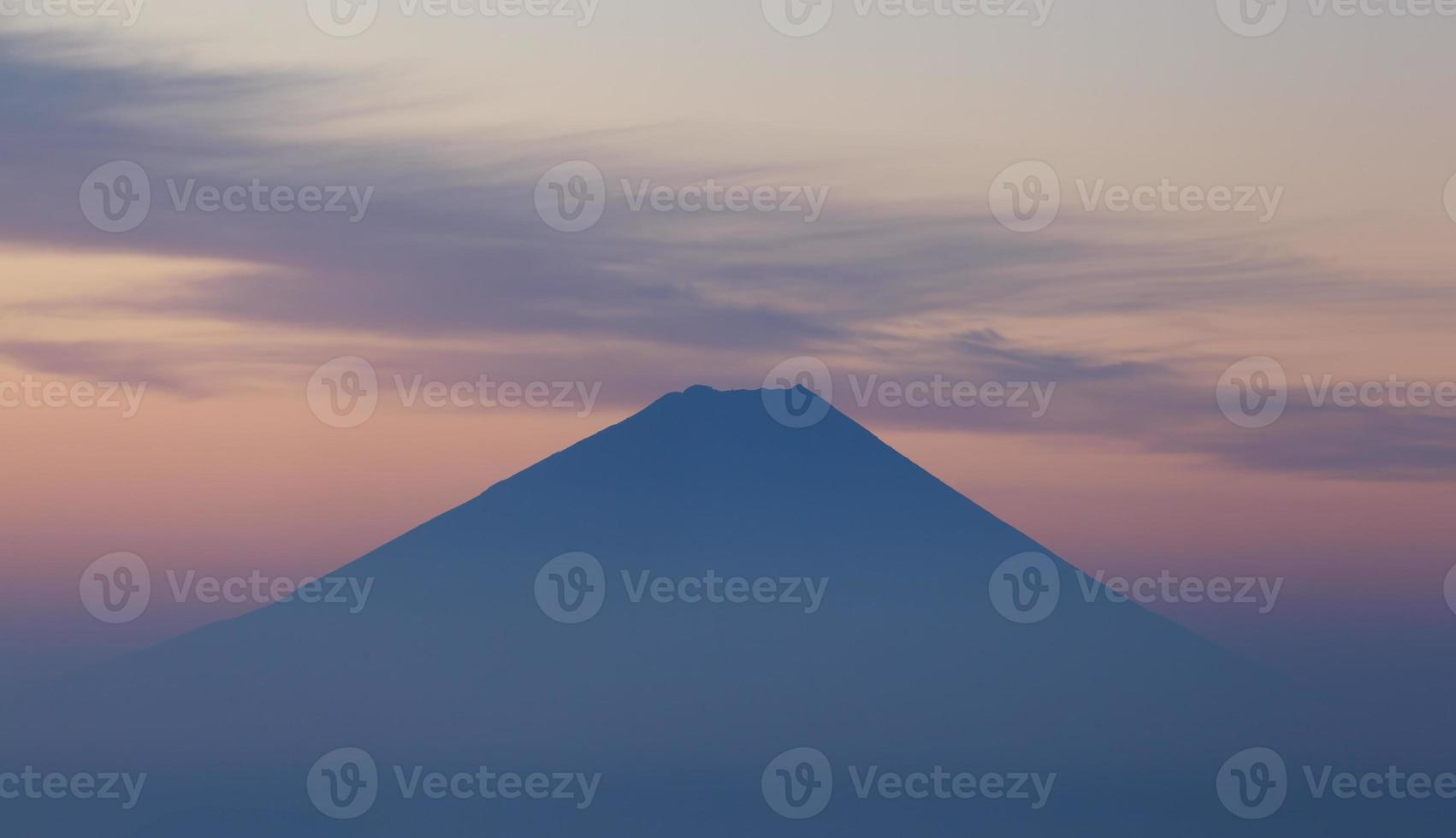 Top of Mountain Fuji and cloud at sunrise time photo