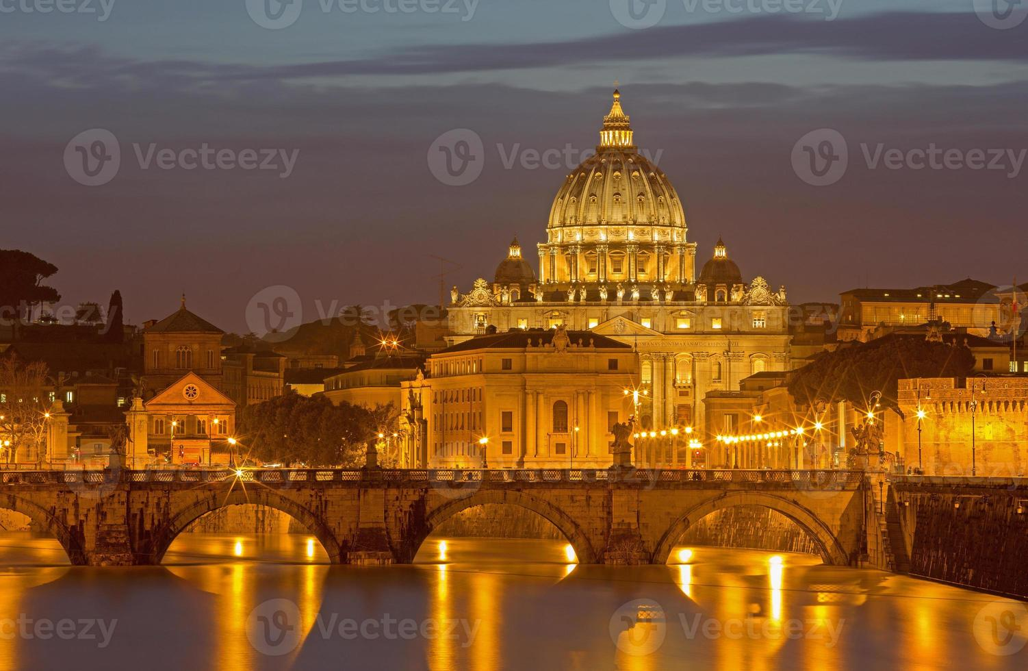 Rome - Angels bridge and St. Peters basilica in evening photo