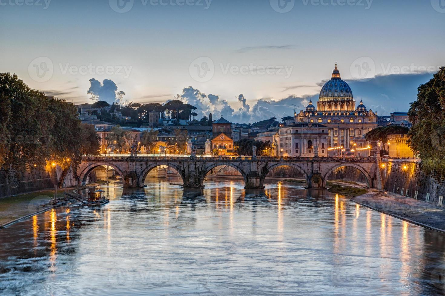 St. Peter's Basilica at dusk in Rome, Italy photo