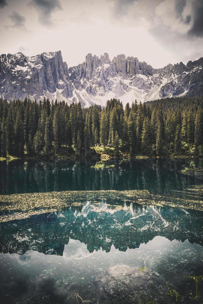 Lake with forest and mountains photo