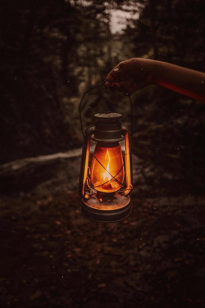 Person holding a lantern in autumn outdoors photo