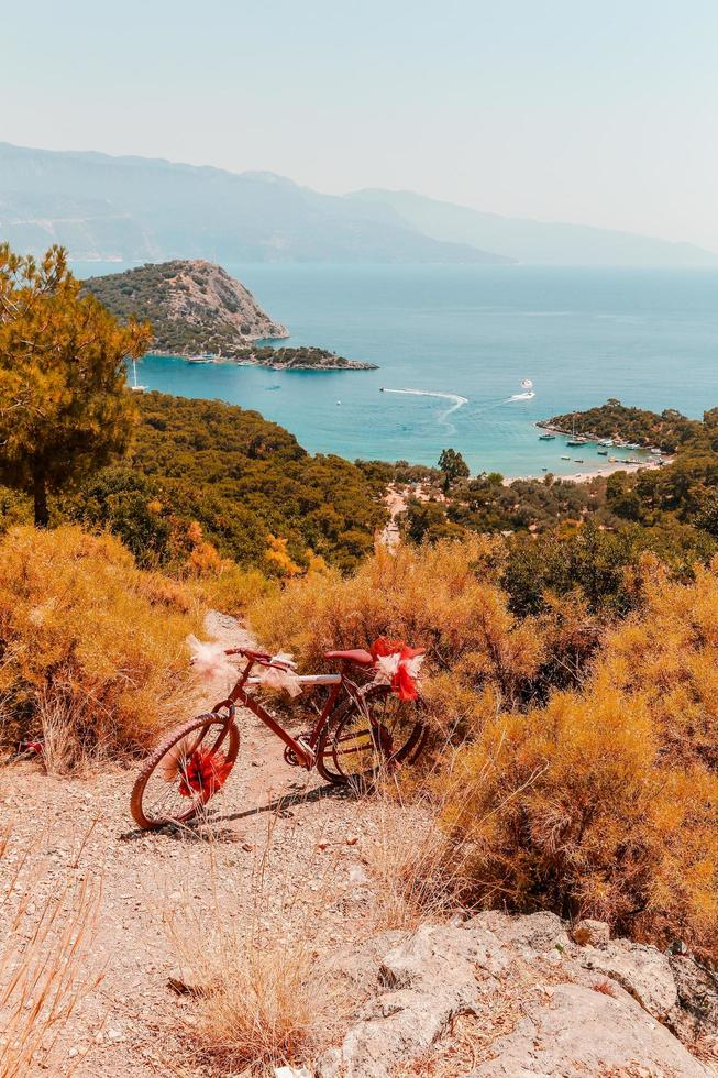 Bicycle on rocky cliff in nature photo