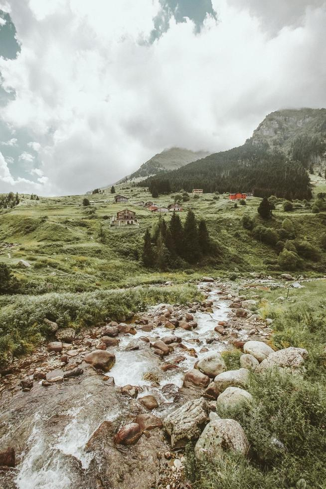 Mountain slope with waterfall in valley photo