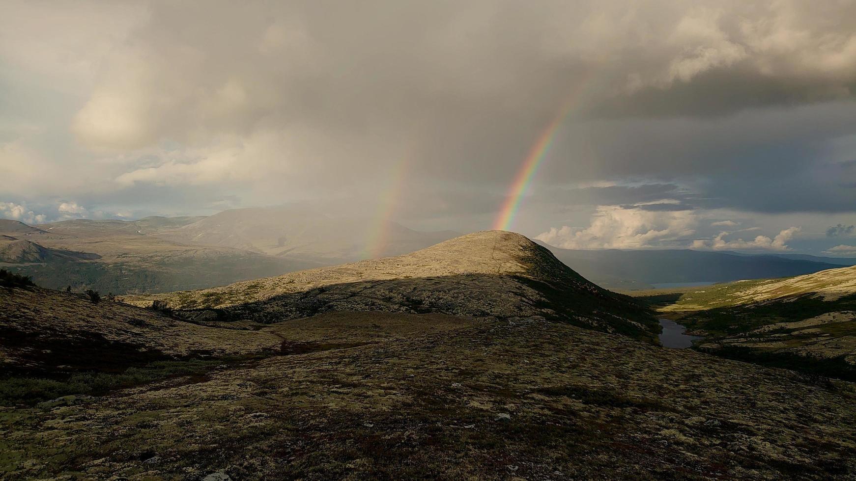 Rainbows over mountains photo