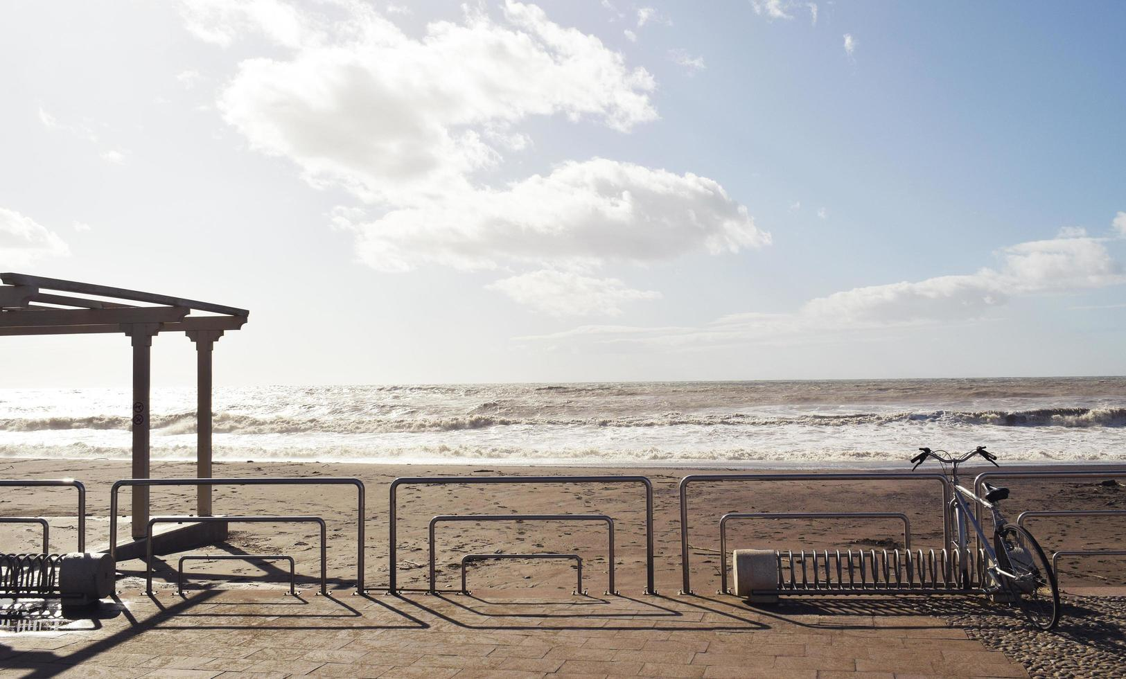 Bike fence on beach during daytime photo