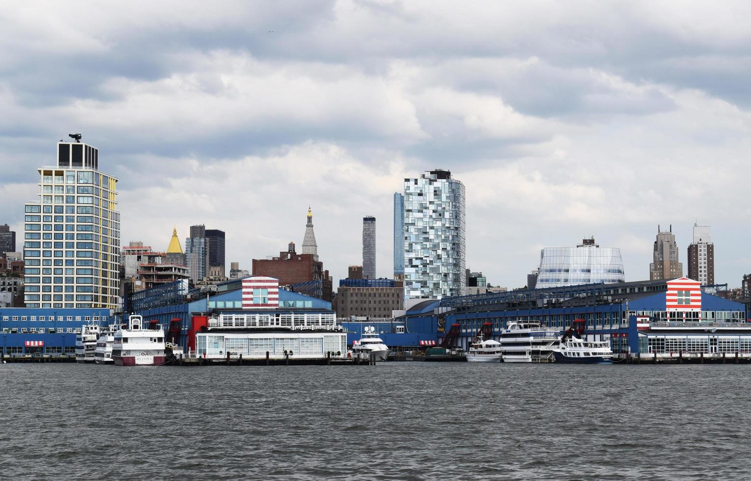 Ships on the sea near city buildings during daytime photo