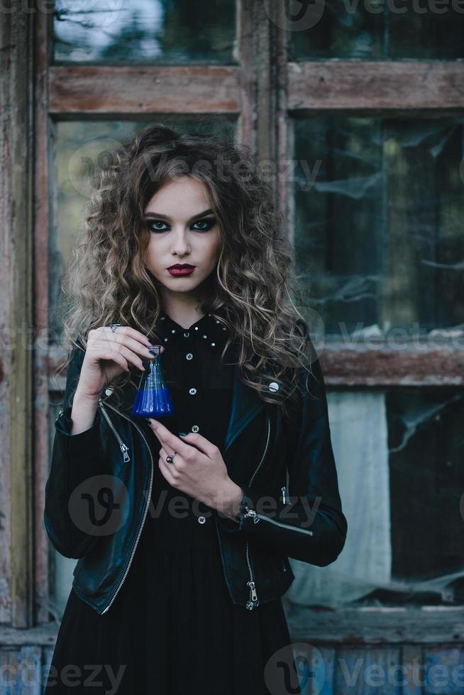 Vintage witch with elixir in hand photo