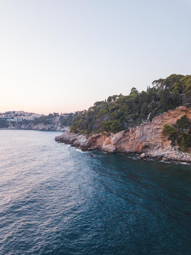 Blue ocean near a cliff photo