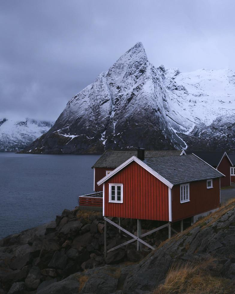 Norway, 2020 - Red wooden house in front of mountain photo