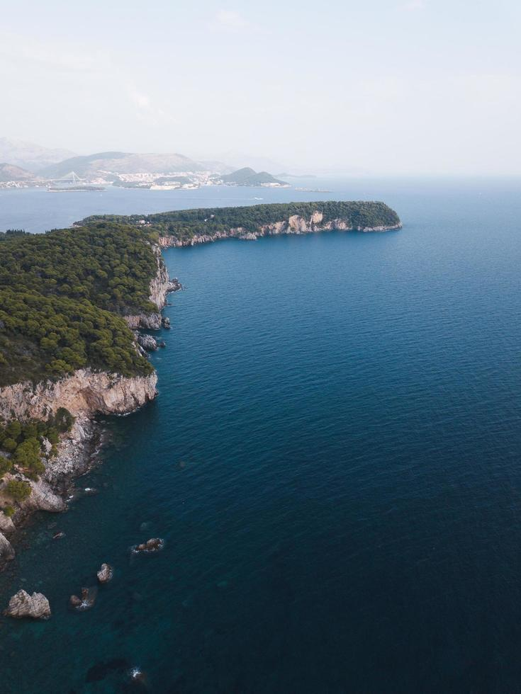 Aerial view of green cliff near ocean photo