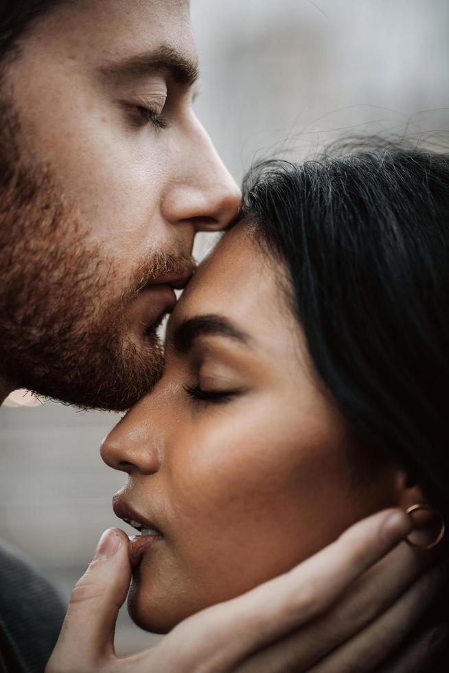 Attractive couple embraces photo