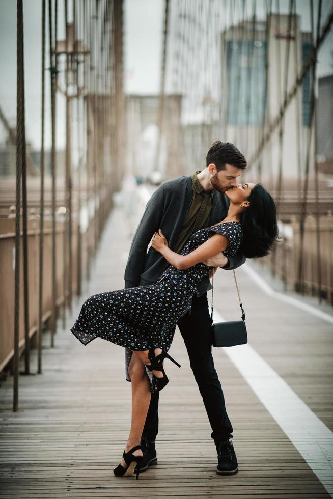 Attractive couple embraces in the city photo