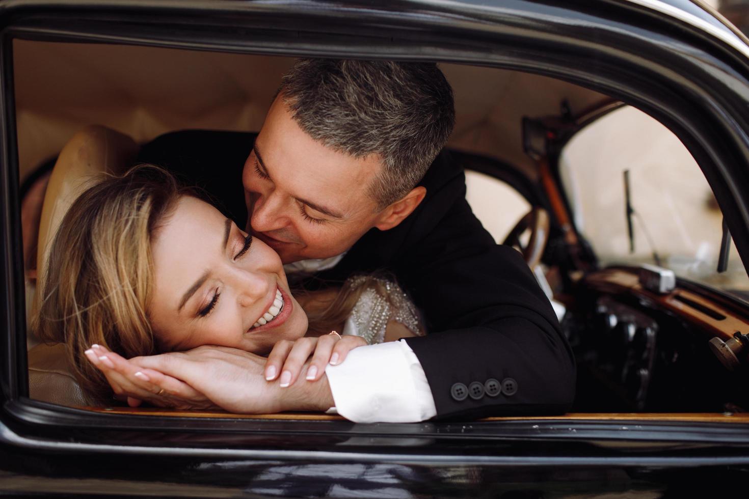 Classy wedding couple embrace photo