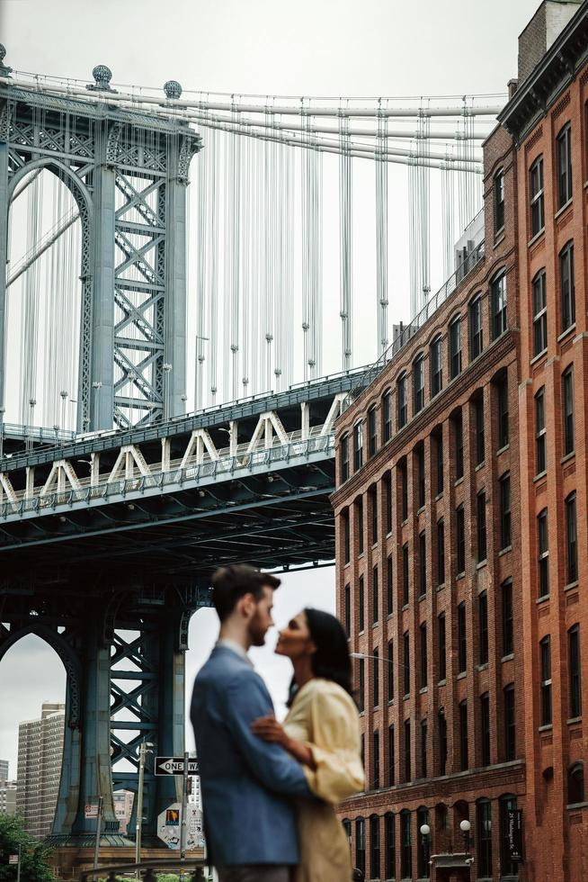 Attractive couple embraces in city street photo