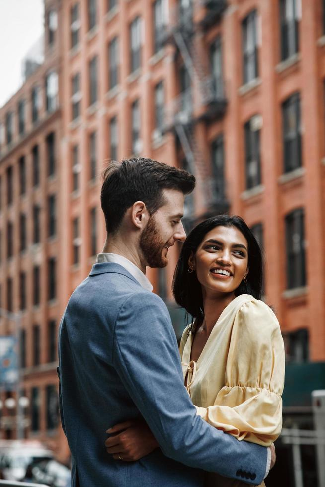 Attractive couple embraces in New York City photo