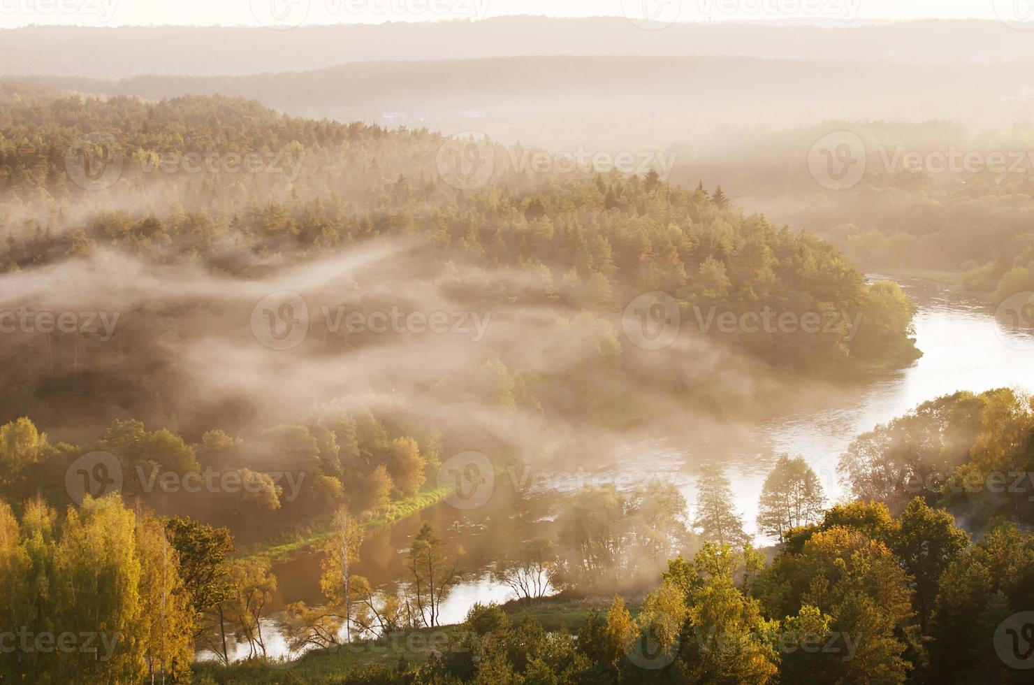 Fog over Neris river in Lithuania photo