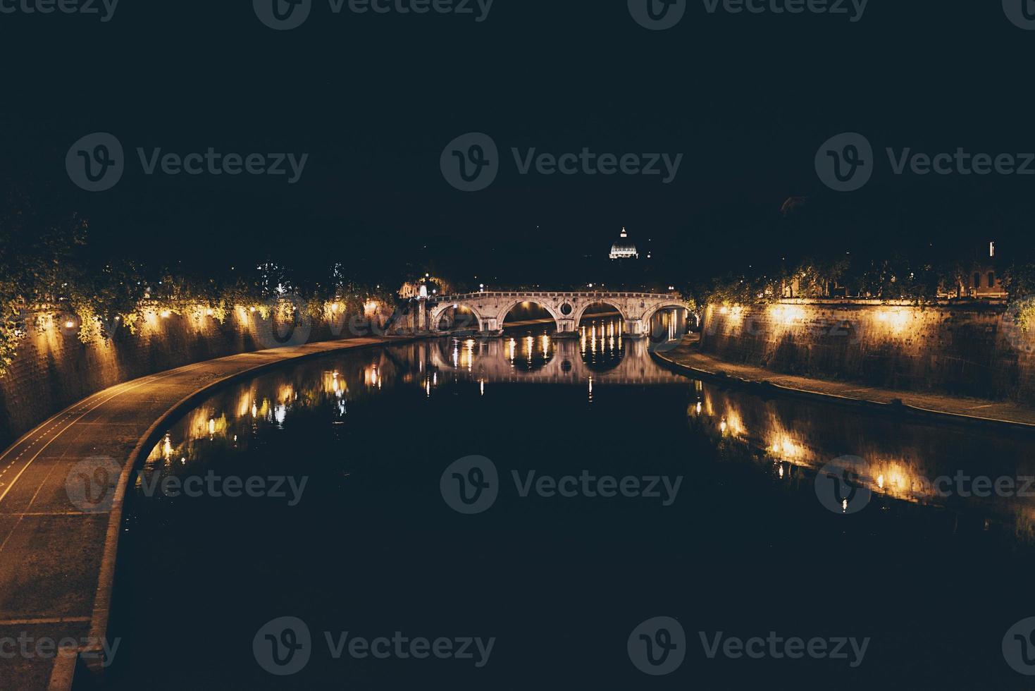 Tiber river at night running through Rome, Italy. photo