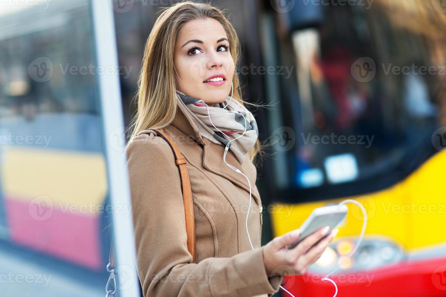 Woman Waiting at Bus Stop photo