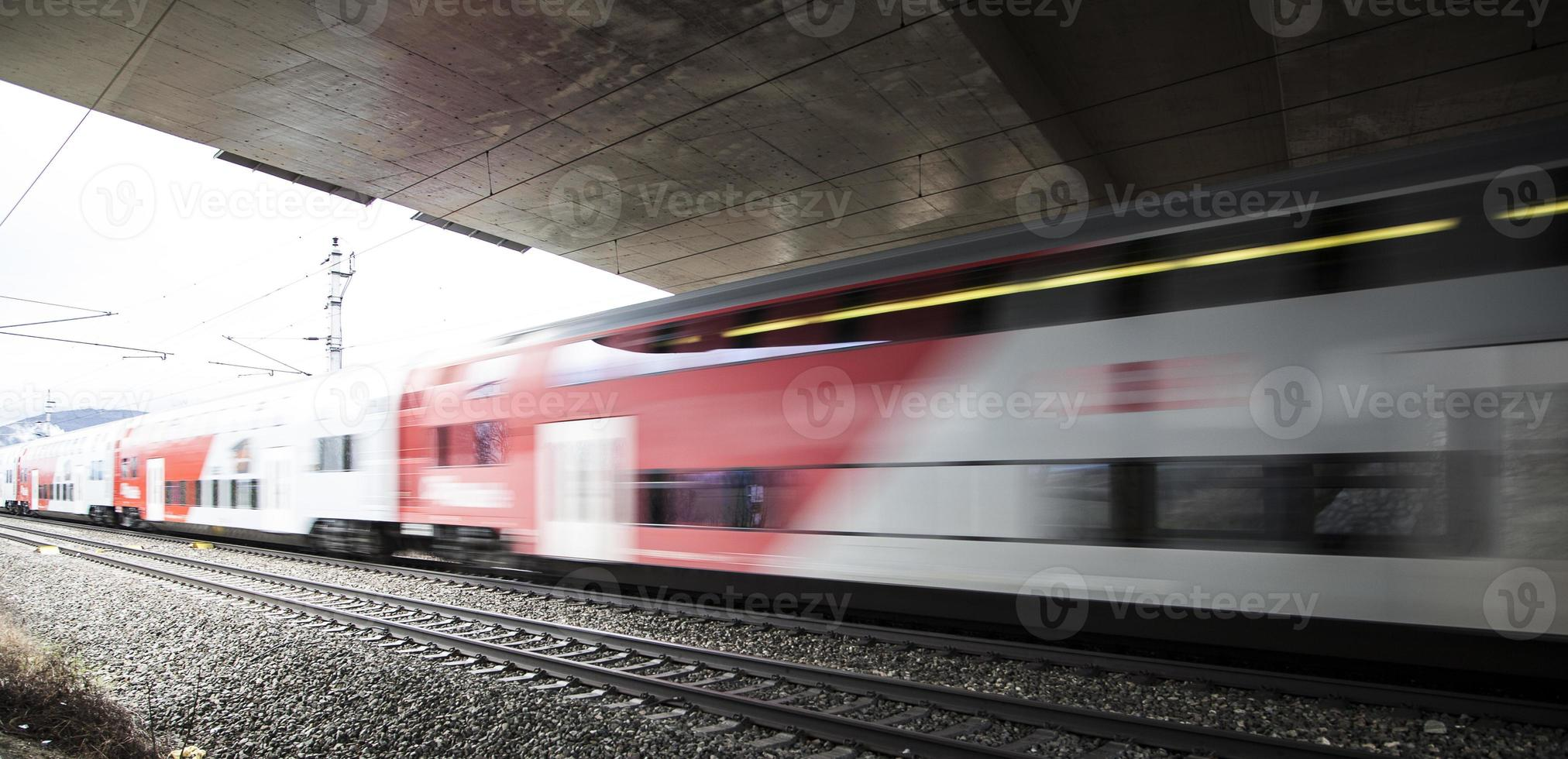 fast train passing by under the bridge photo