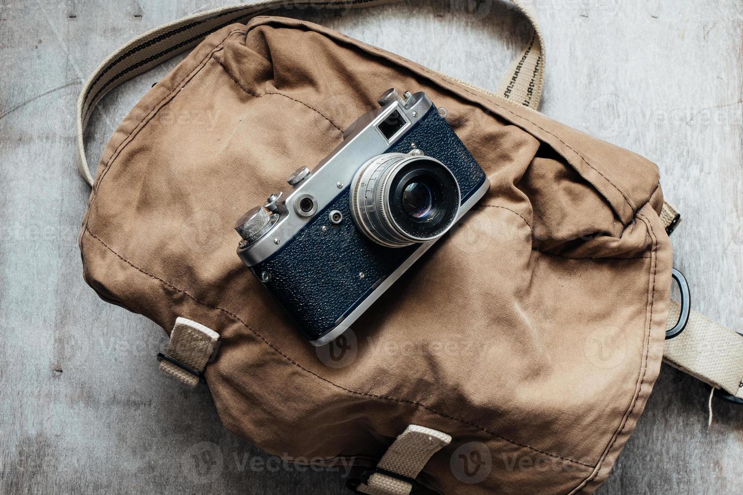 Old camera in bag, vintage photo grunge design component