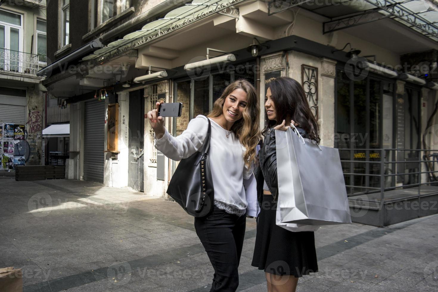 Two girls make selfie at the street photo