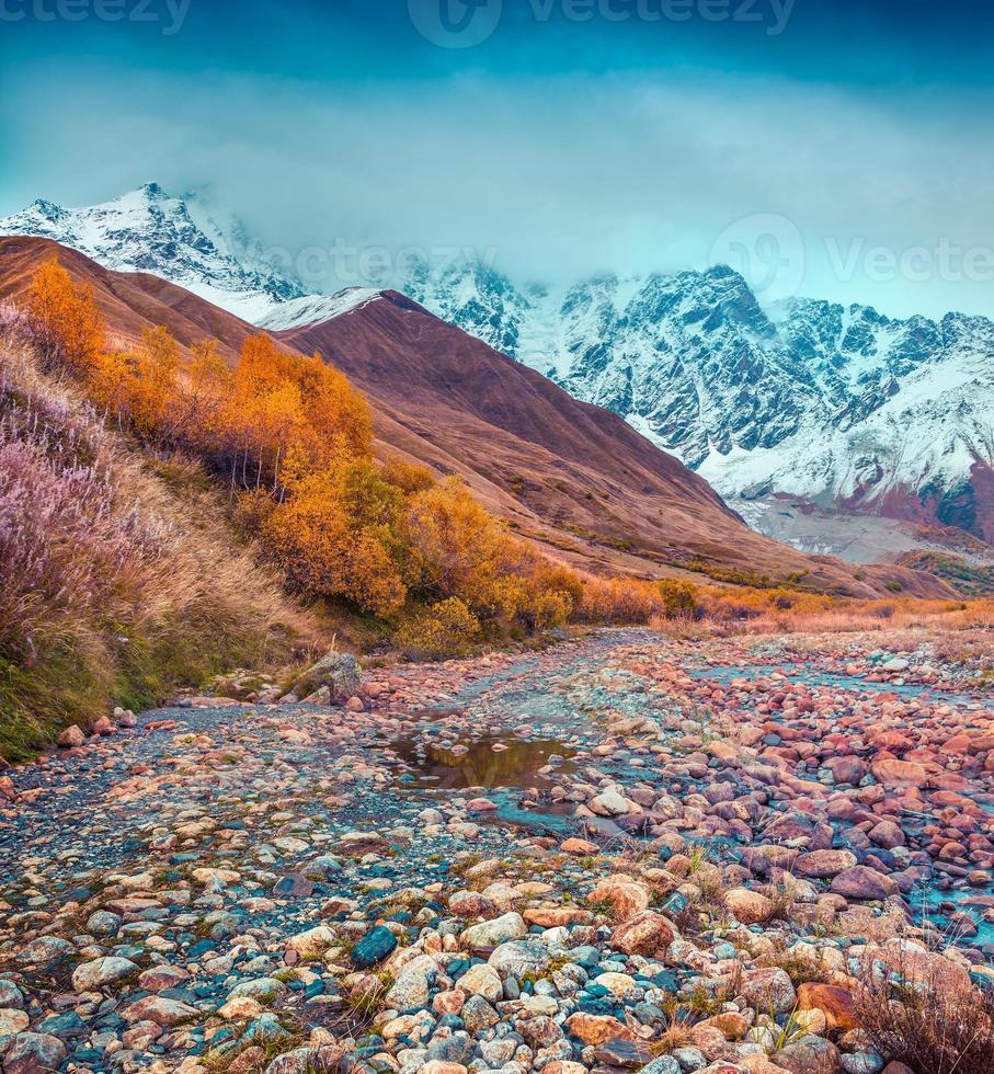 Foggy autumn morning in the Caucasus mountain. photo