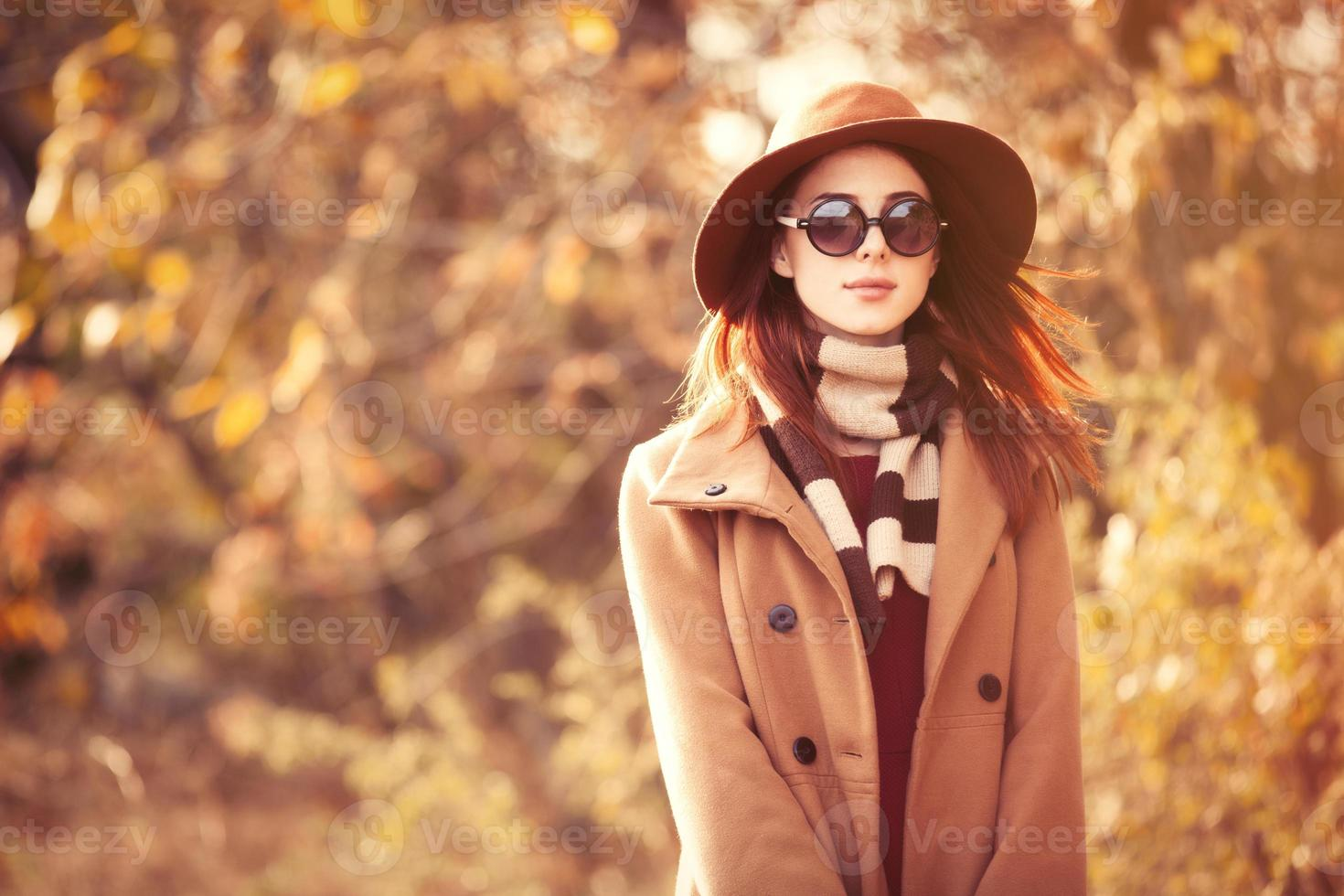 Woman in autumn park photo