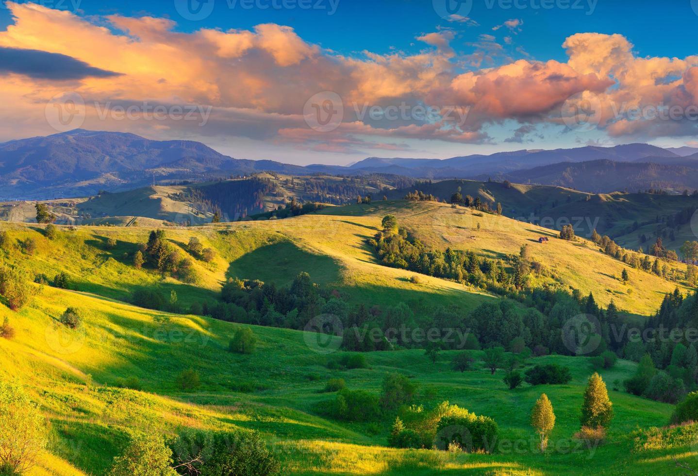 Colorful summer sunrise in the Carpathian village photo
