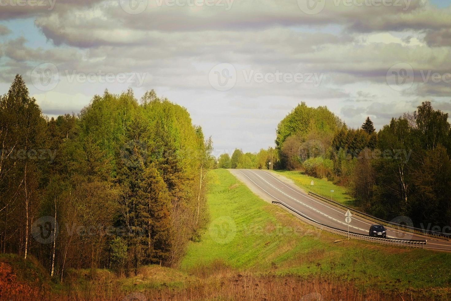 rural landscape road stretches into the distance photo