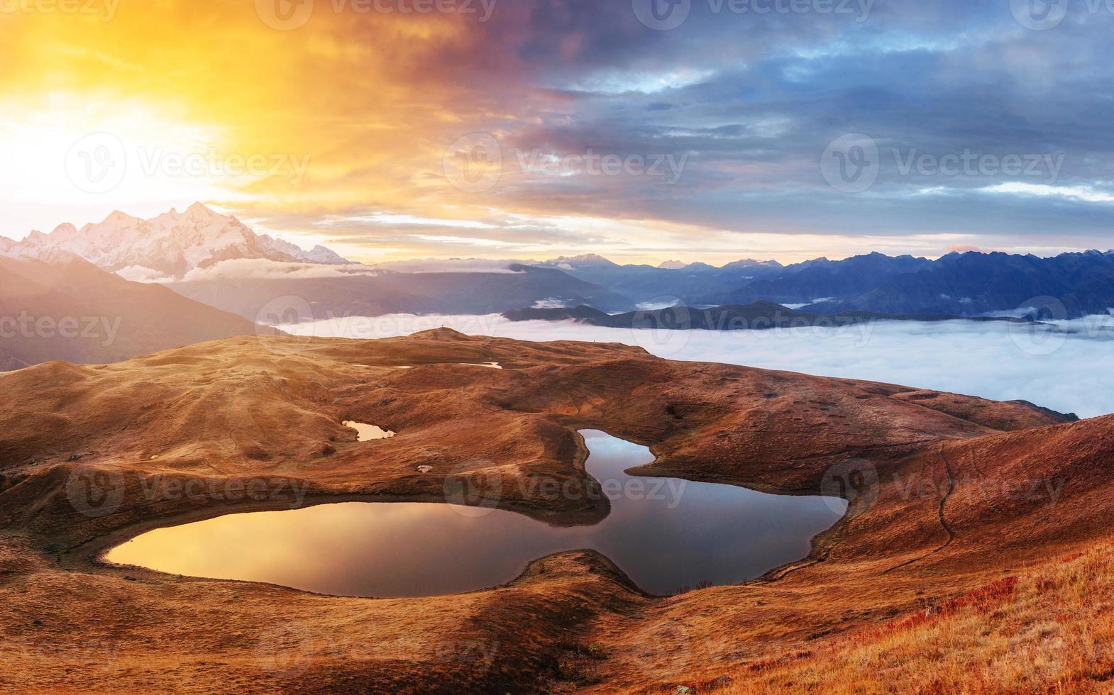 Sunset on mountain lake Koruldi. Upper Svaneti, Georgia, Europe. photo