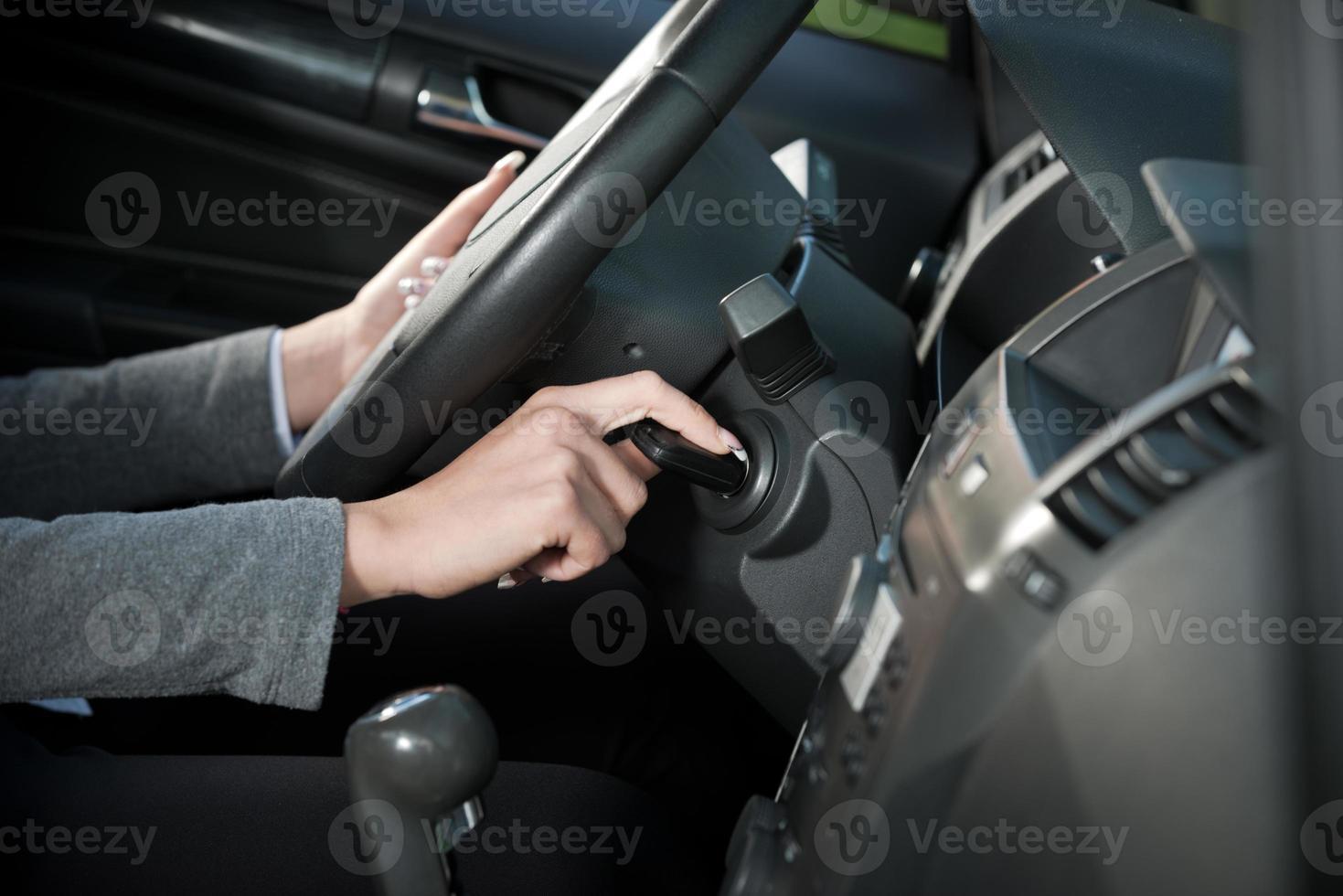 Woman starting car engine photo