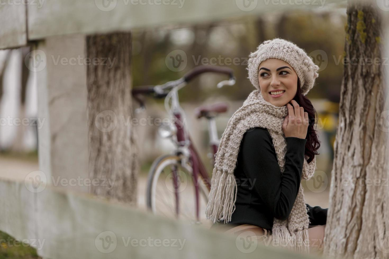 Young woman with bicycle photo