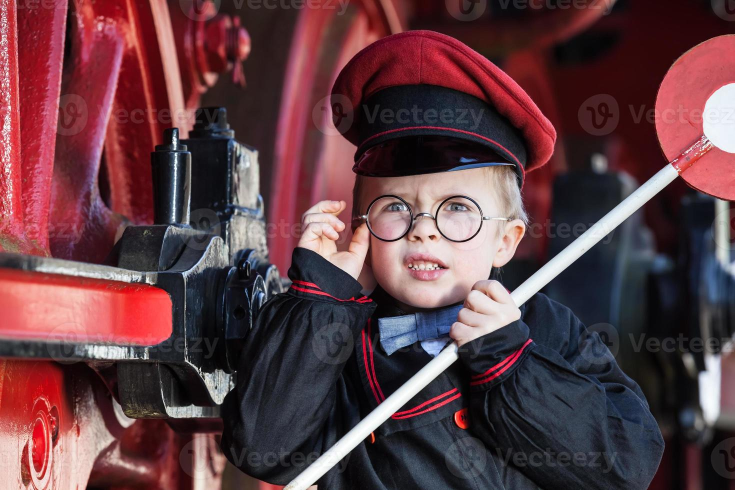 Upset Little Railroad Conductor photo