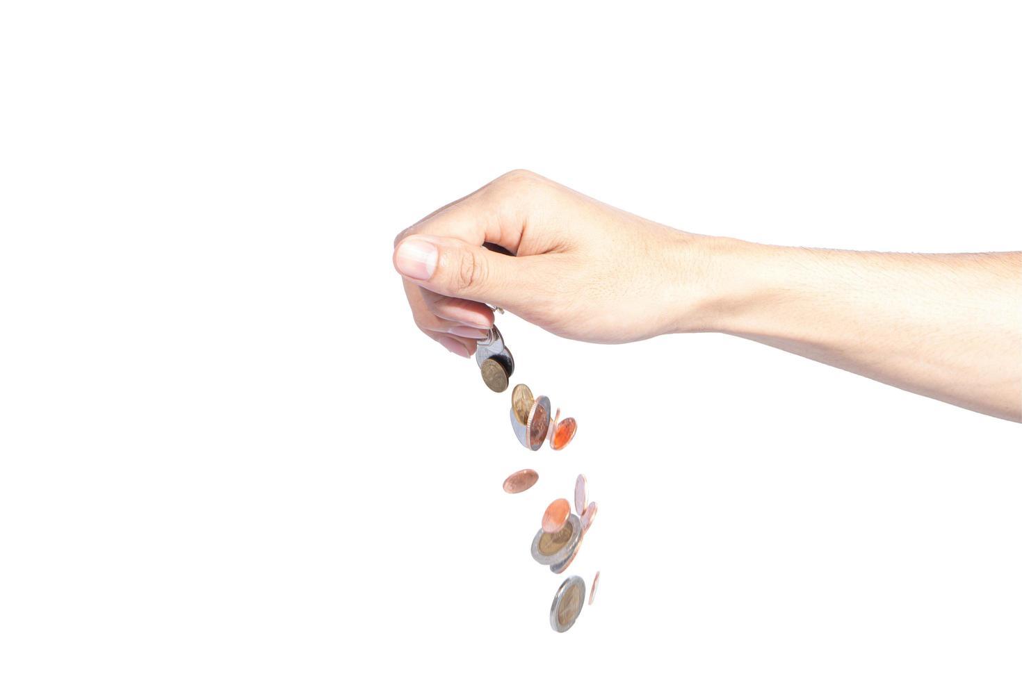 monedas cayendo de una mano foto