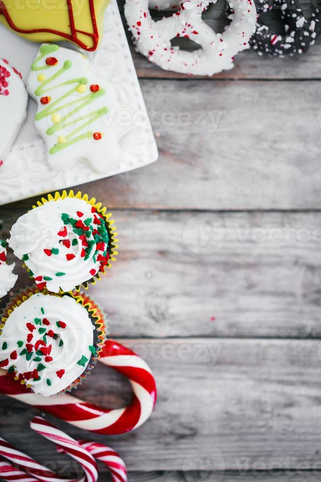 Christmas cupcakes on wooden background photo