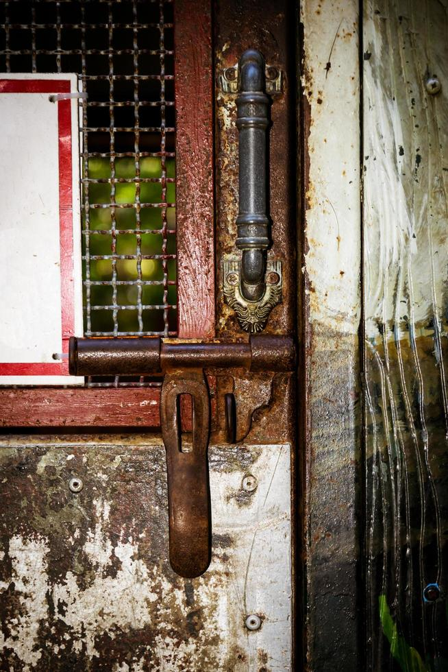 Close-up of an illuminated steel door photo
