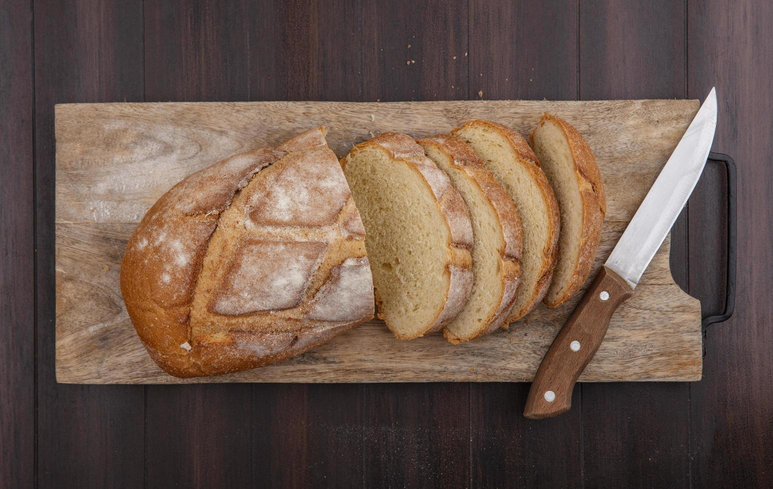 Food photography flat lay of baked bread on wooden background photo