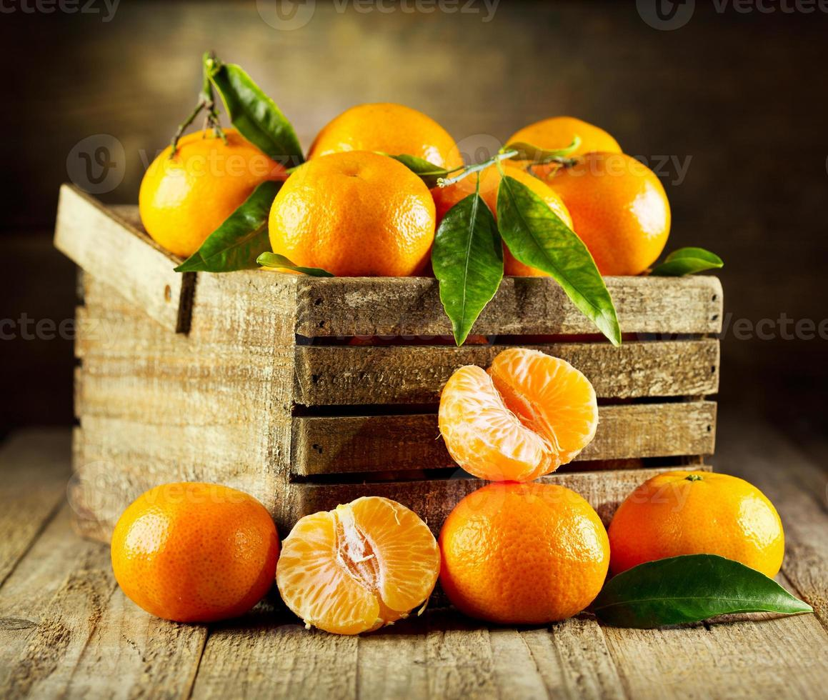 fresh tangerines with leaves photo