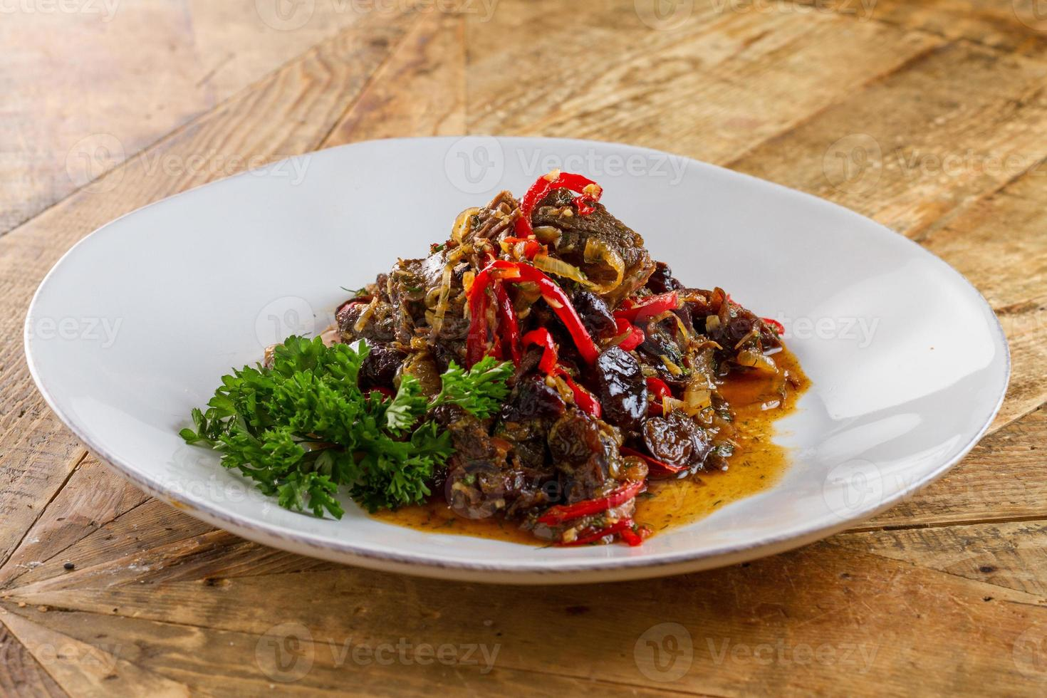 Main course with meat on wooden table photo