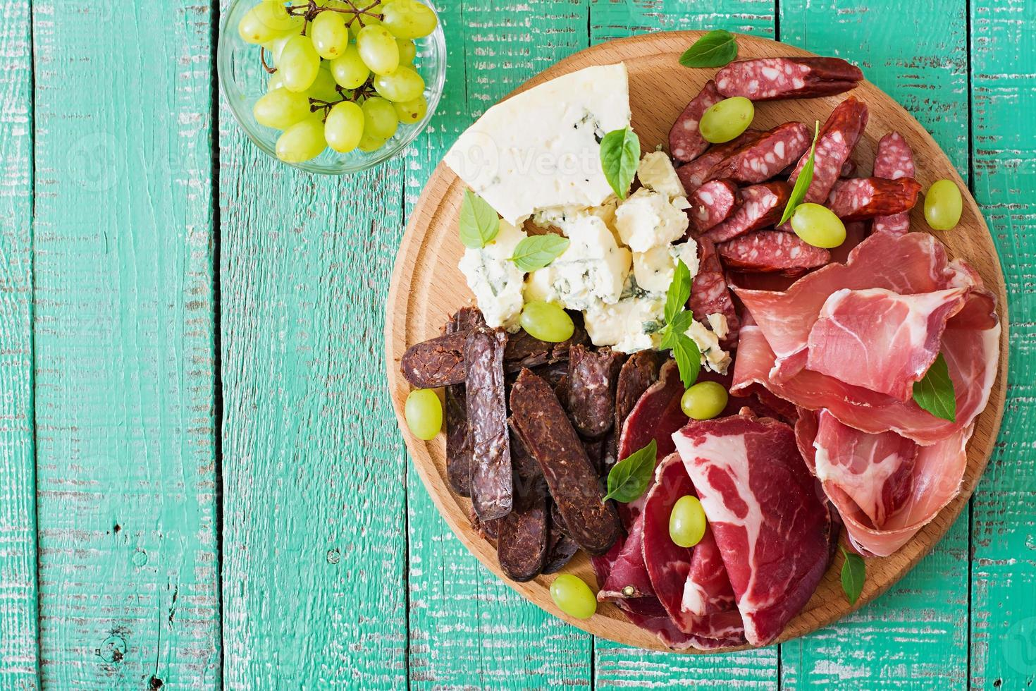 Antipasto catering platter with bacon, jerky, sausage, blue cheese photo