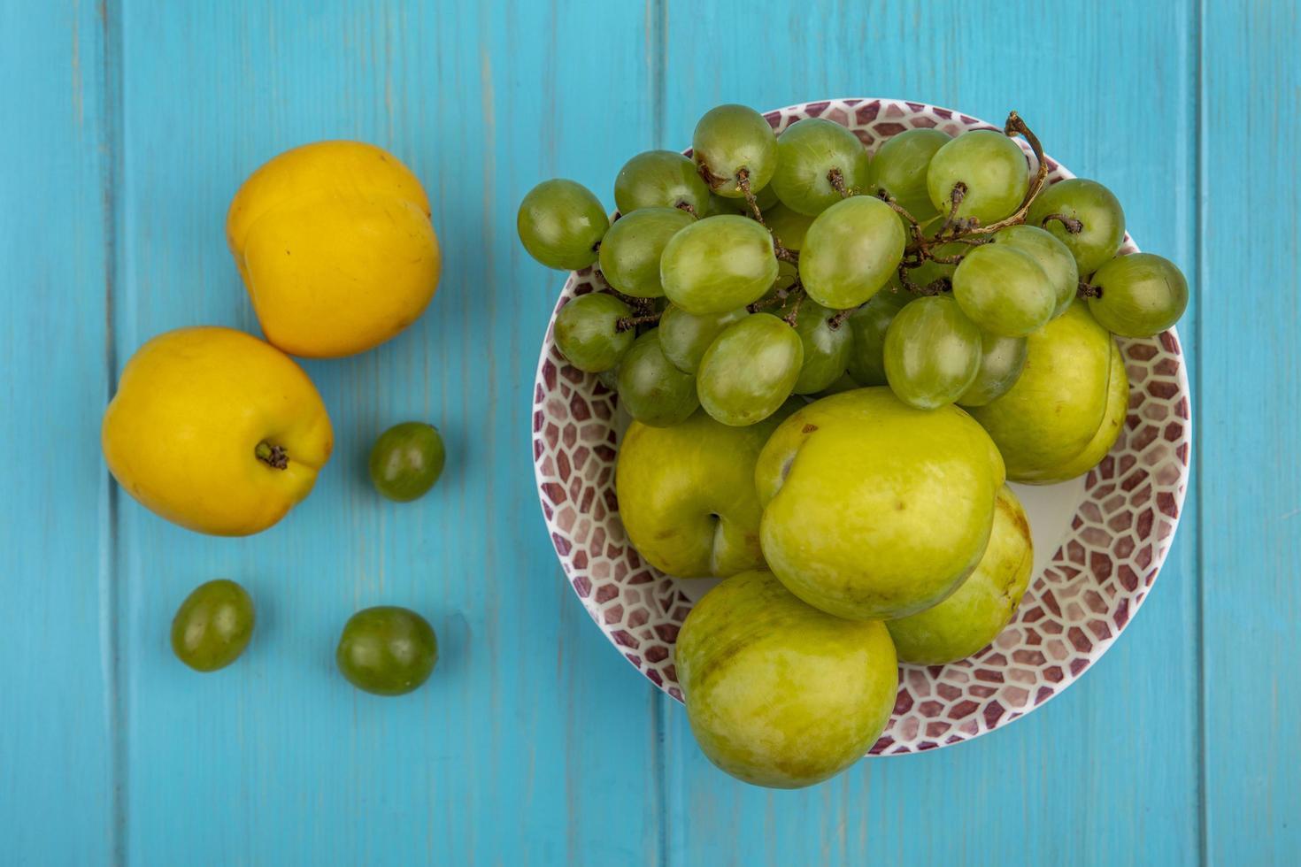 Assorted fruit on blue background photo