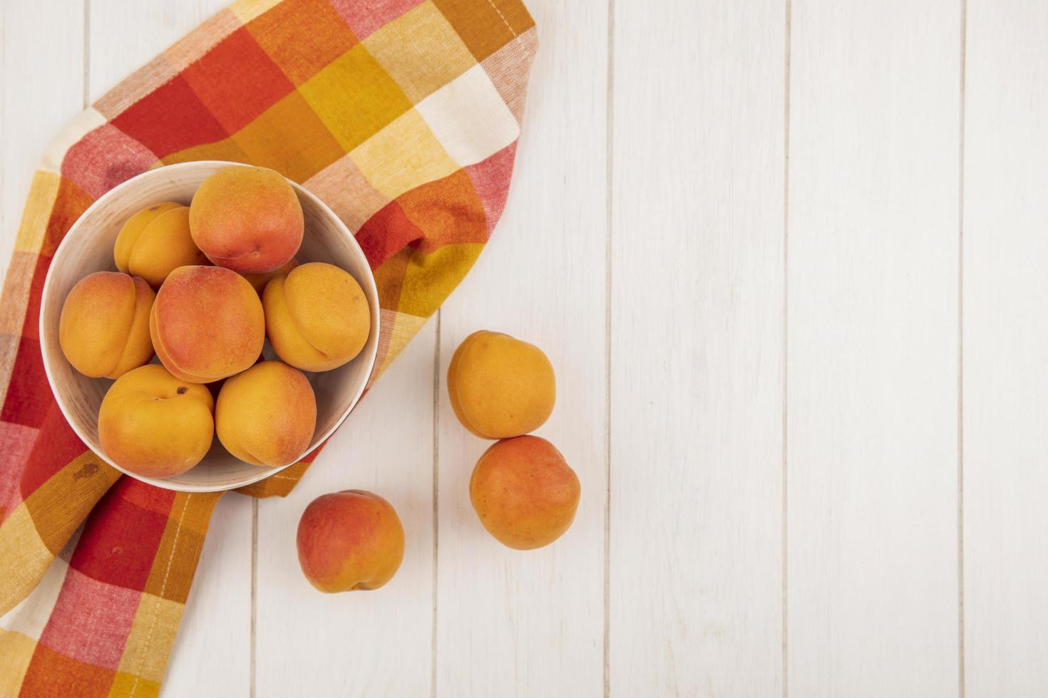 Apricots on wooden background with copy space photo