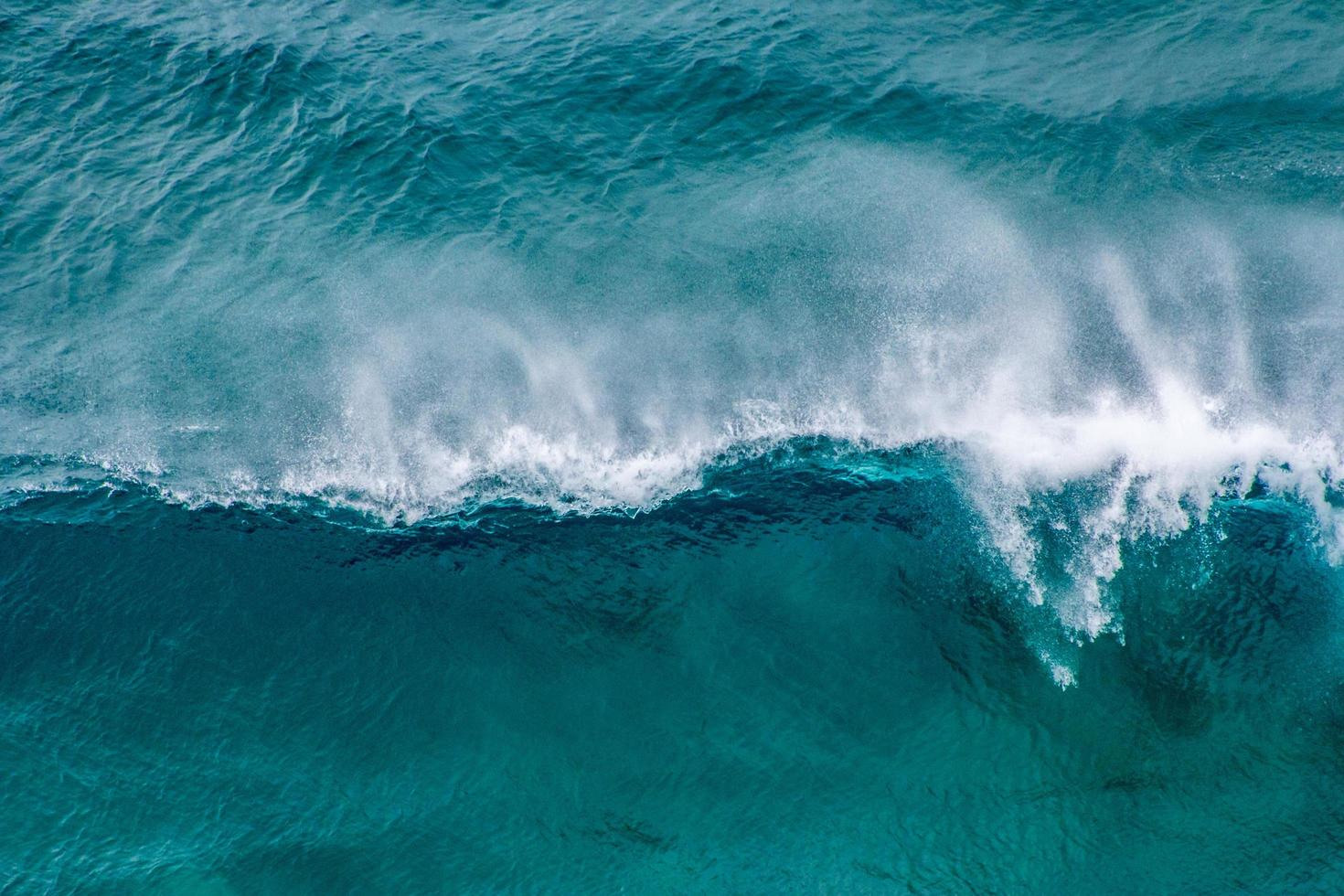 Aerial view of blue ocean waves photo
