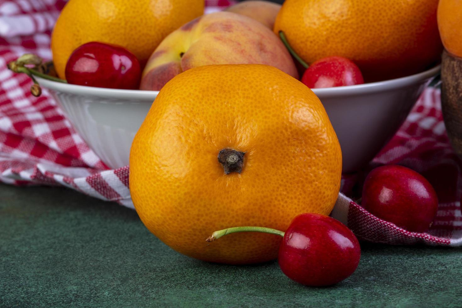 Side view of fresh ripe tangerines photo