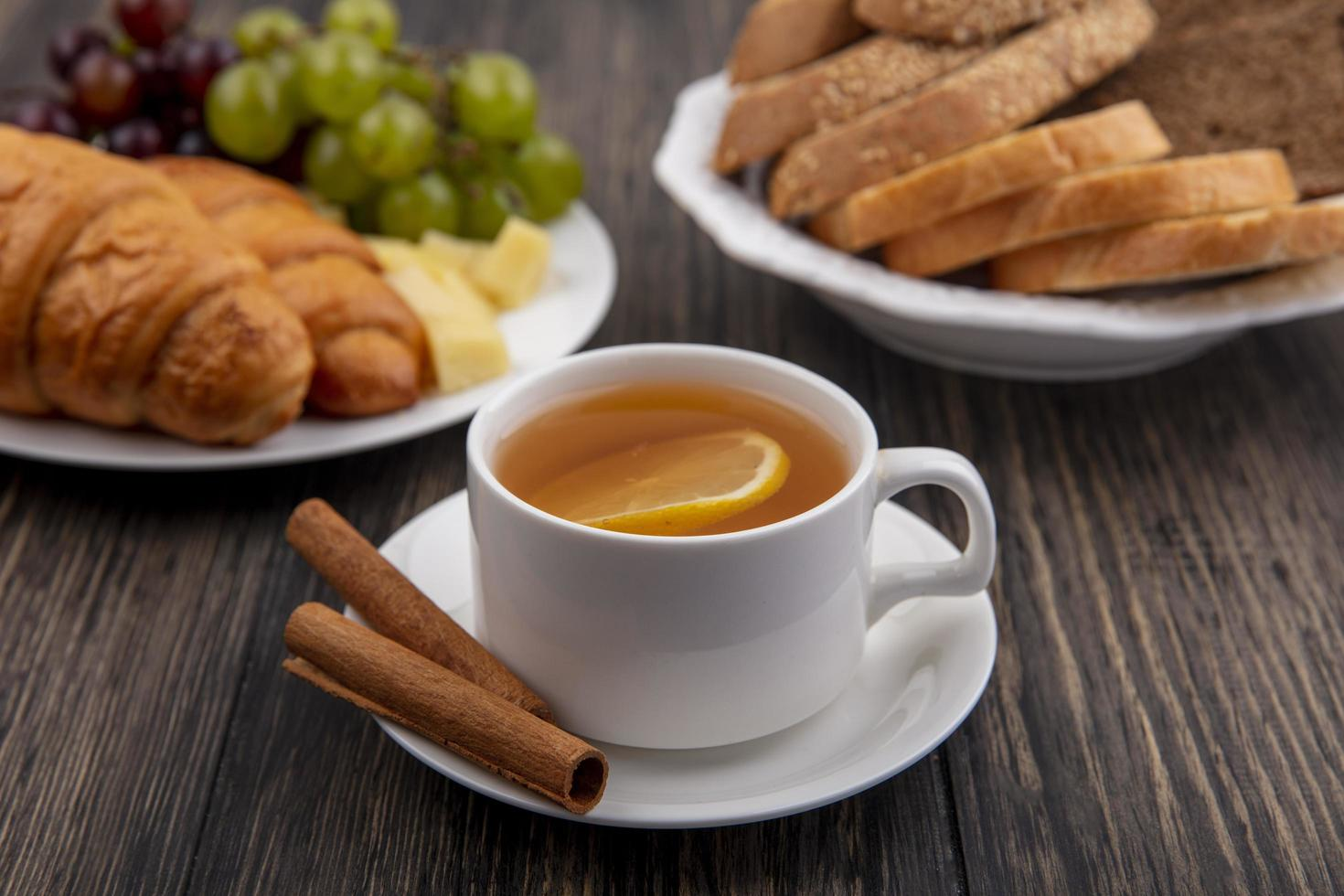 Side view of a cup of hot toddy with cinnamon photo