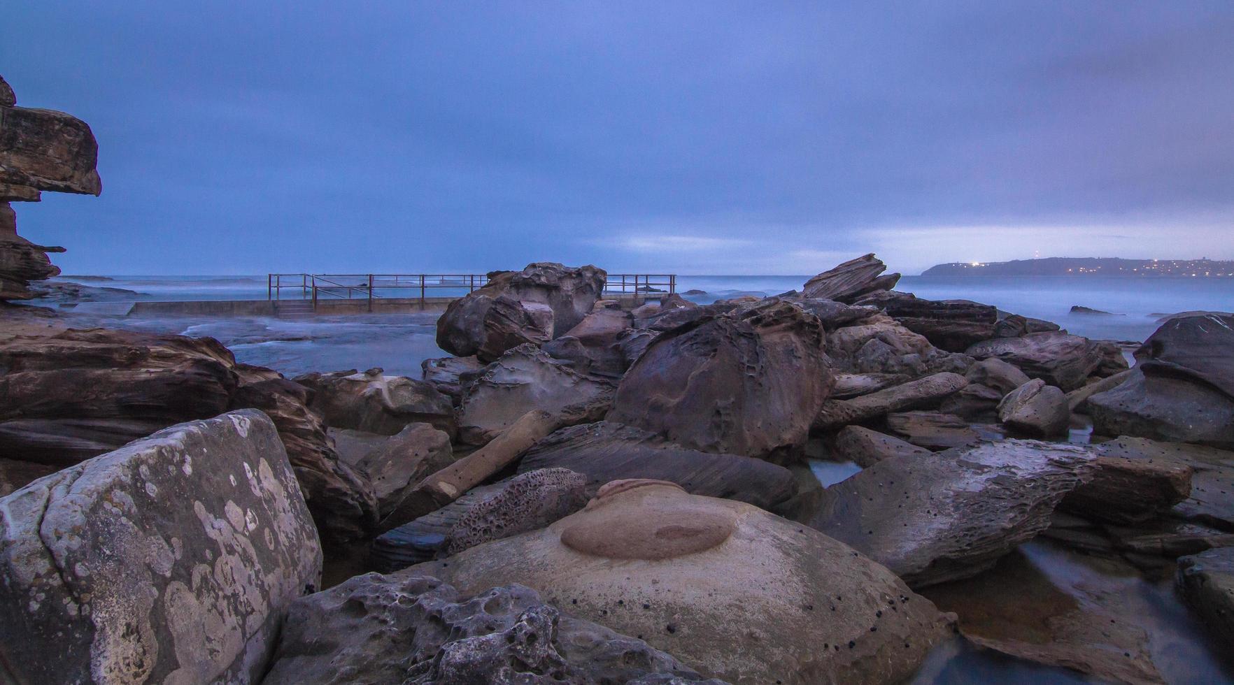 Rocky coast at night photo