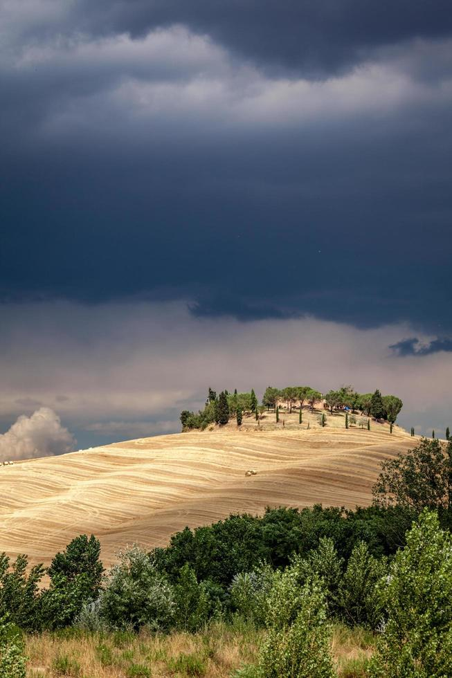 Tuscany, Italy, 2020 - House on a hill under a stormy sky photo