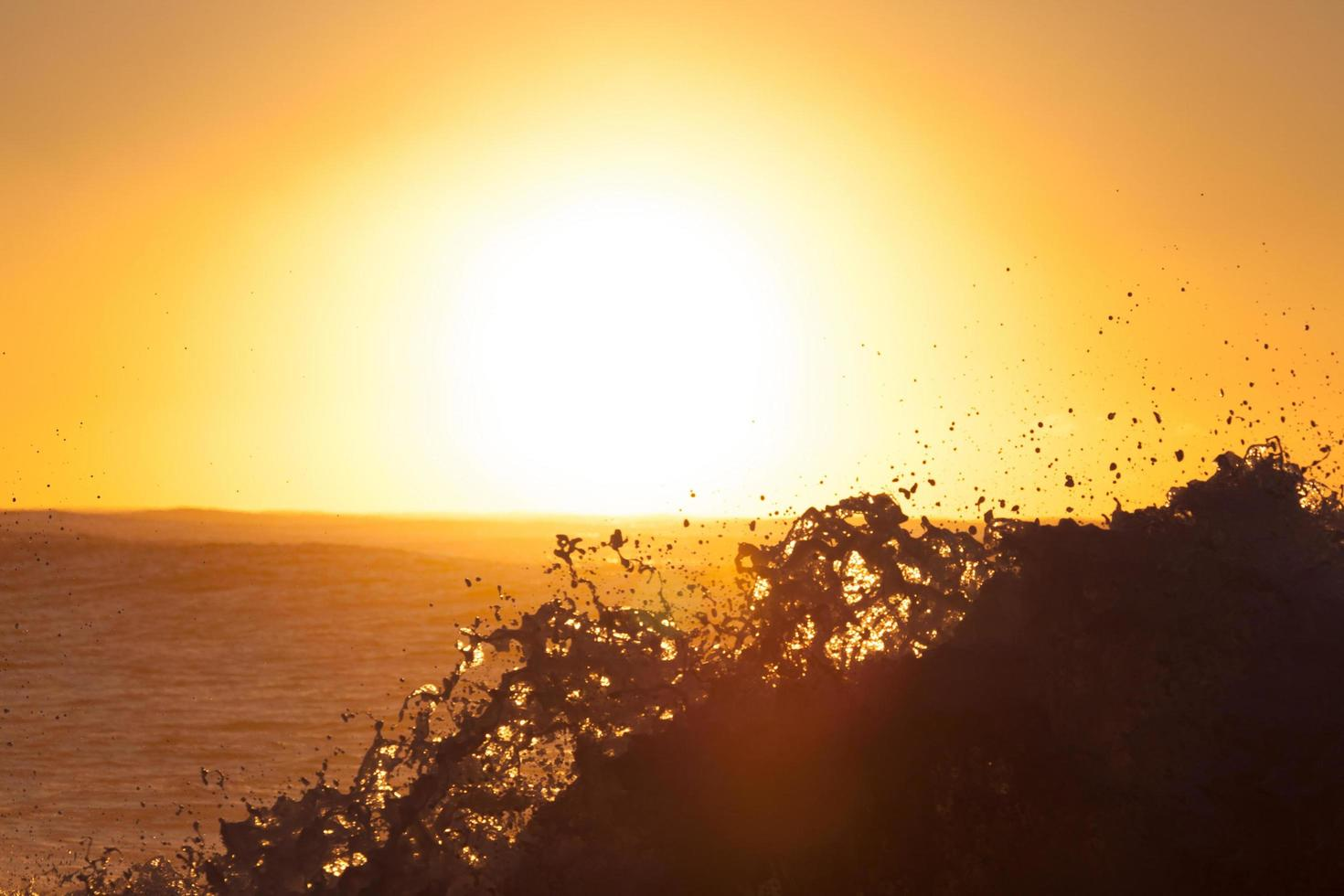 Ocean waves at golden hour photo