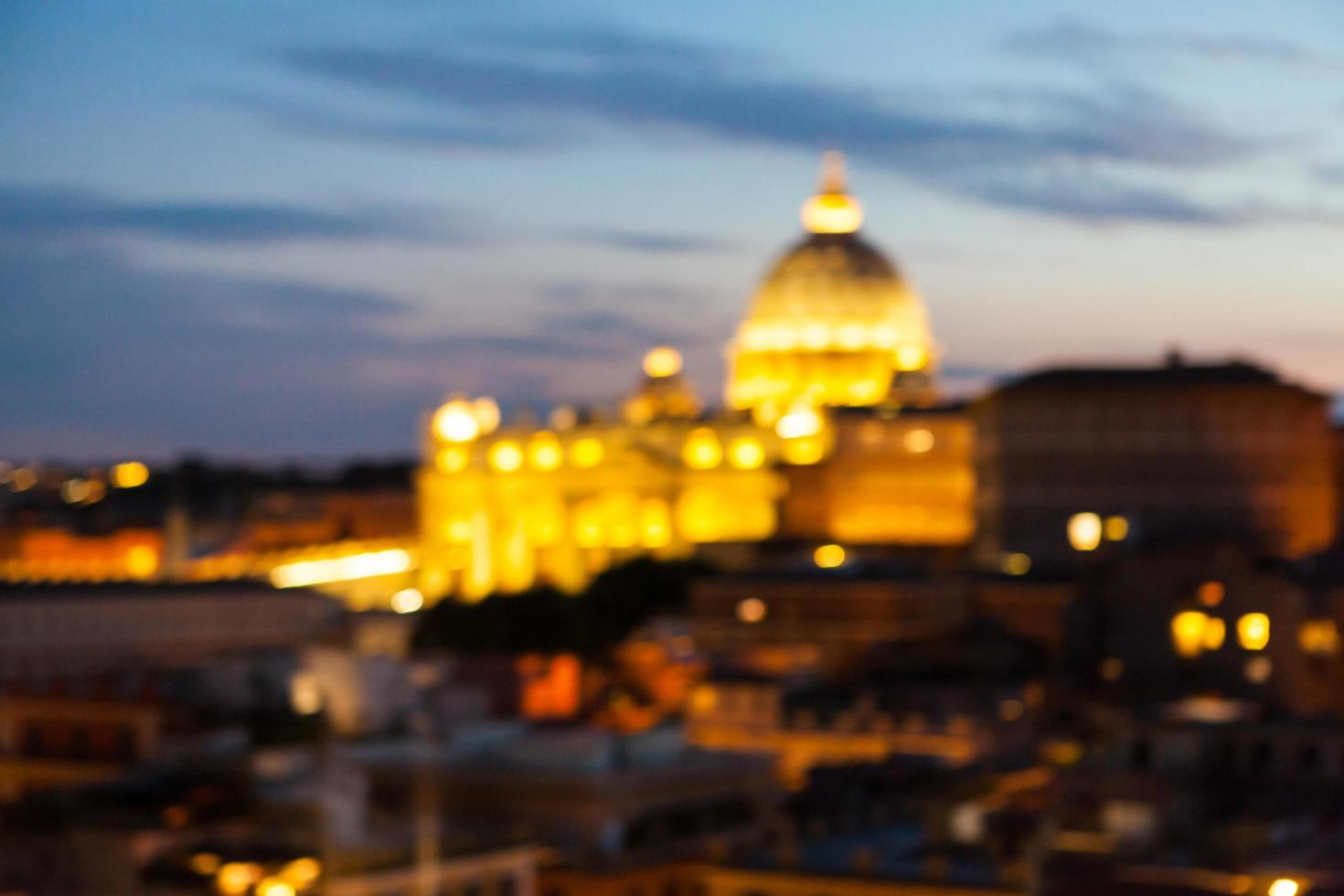 Blurry city lights with a domed building photo