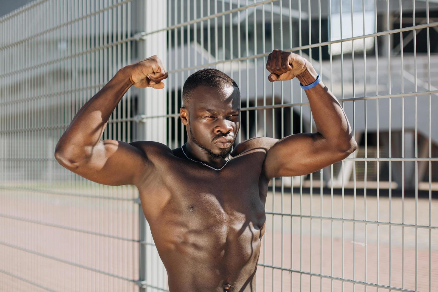 Fit man showing arm muscles photo